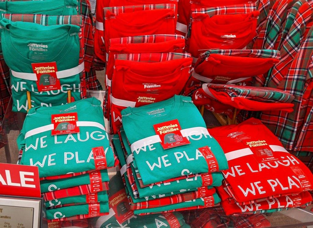 folded red and green sets of family christmas pajamas on kohl's display