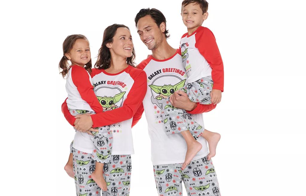 family wearing matching Baby Yoda pajamas