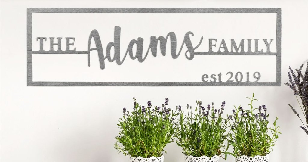 custom steel wall plaque that says the adams family on it