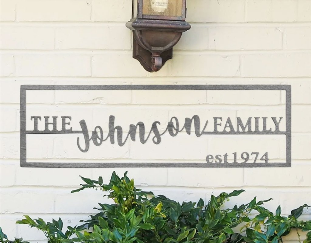 steel wall plaque that says the johnson family on it