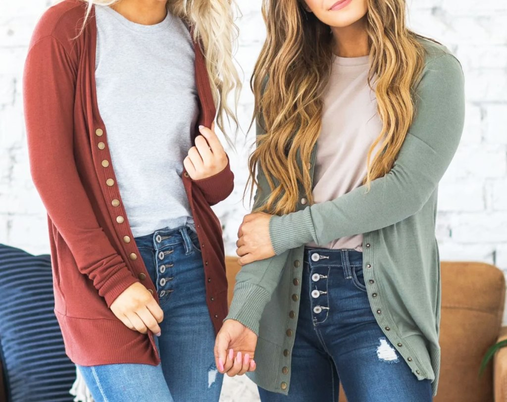 two girls modeling snap front cardigans with jeans and white t-shirts