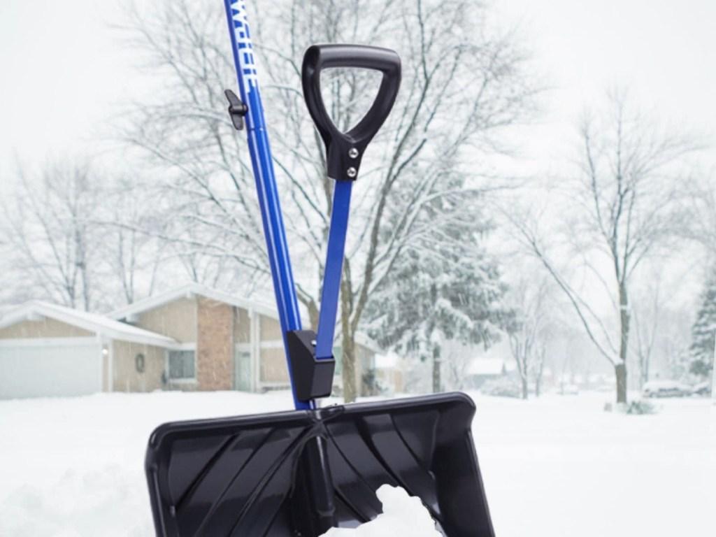Joe Shovel Snow Shovel sitting outside in the snow