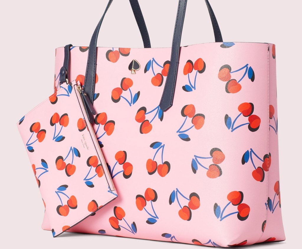 pink kate spade tote bag with allover cherries print and matching wristlet