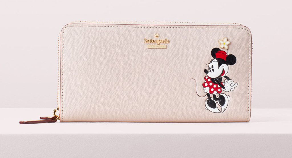 light pink kate spade zippered wallet with minnie mouse printed on it