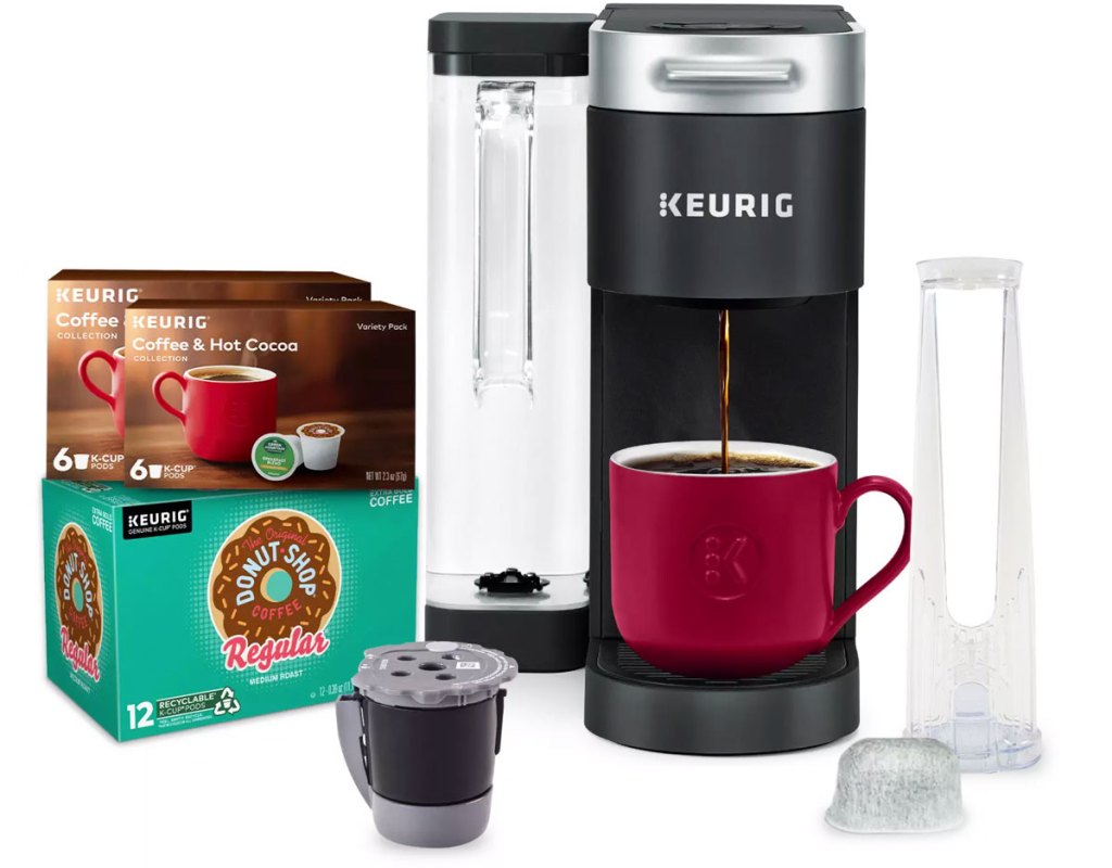 black keuring brewer with boxes of k-cups, refillable k-cup and water filter