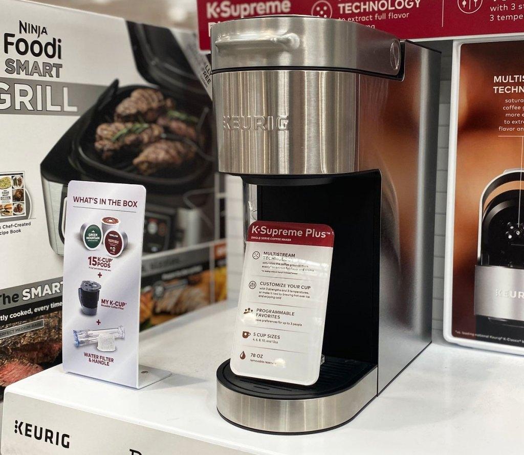 stainless steel keurig single-serve coffee maker on display at costco