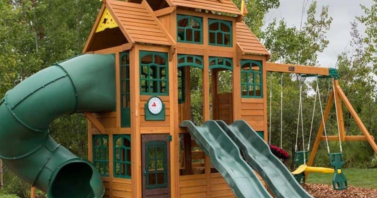 Kidkraft Falcon Ridge Swing Set outside in front of trees