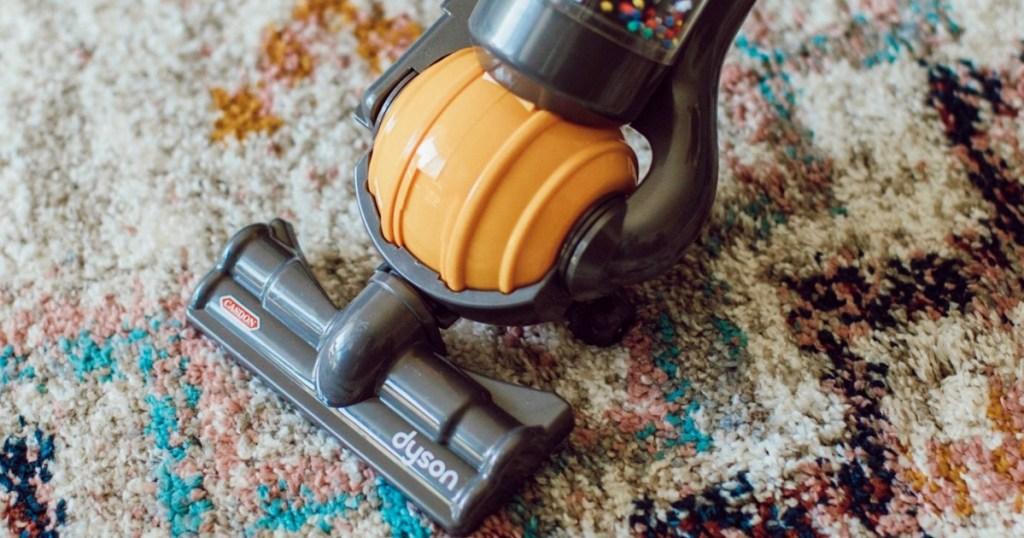 Minature Dyson brand vacuum toy