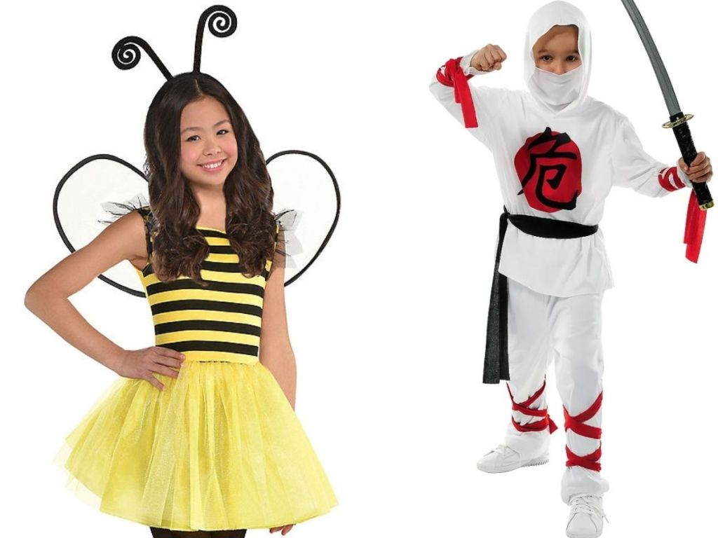 Two kids dressed up for halloween as a bee and a ninja
