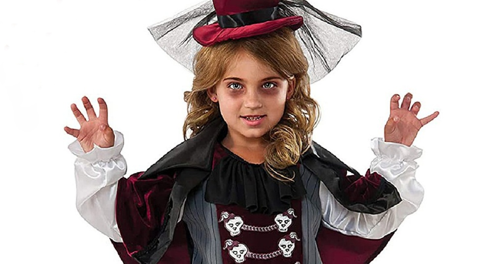 Little girls wearing scary makeup and a fancy vampire halloween costume