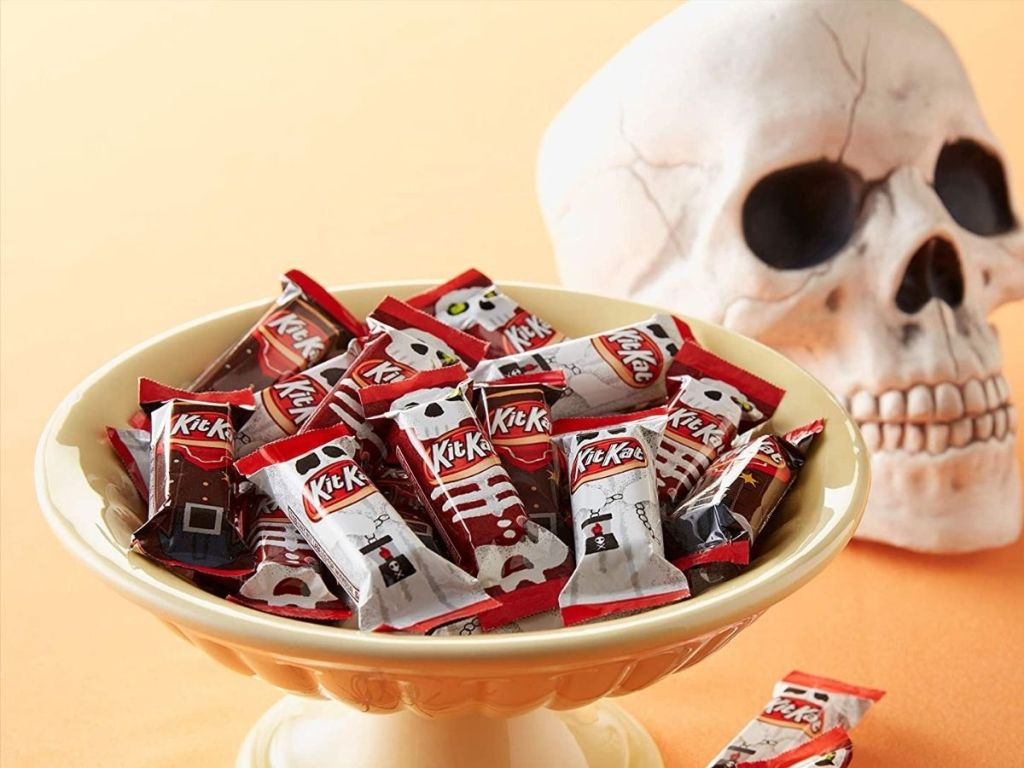 Kit-Kat candy in a bowl with decorative skull behind it