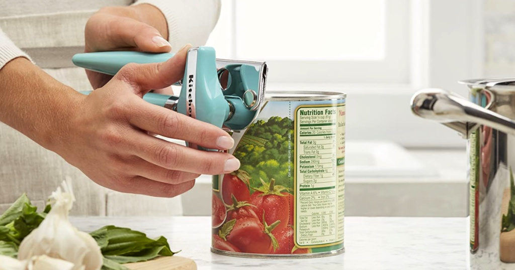 person opening a can with a KitchenAid Classic Multifunction Aqua Sky Can Opener