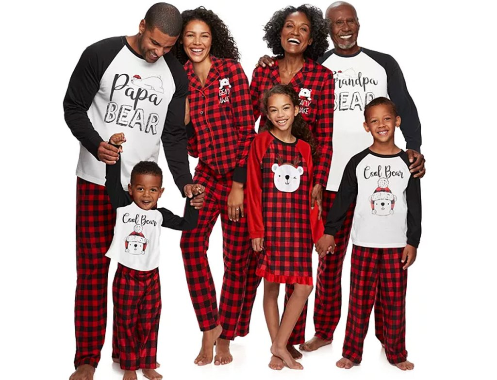 family wearing red, black and white plaid bear themed pajama sets