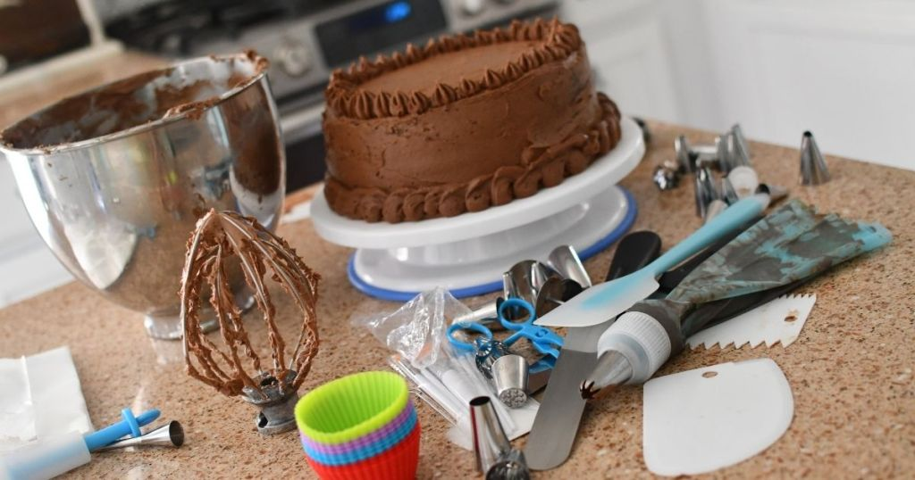 cake decorating tools by a cake