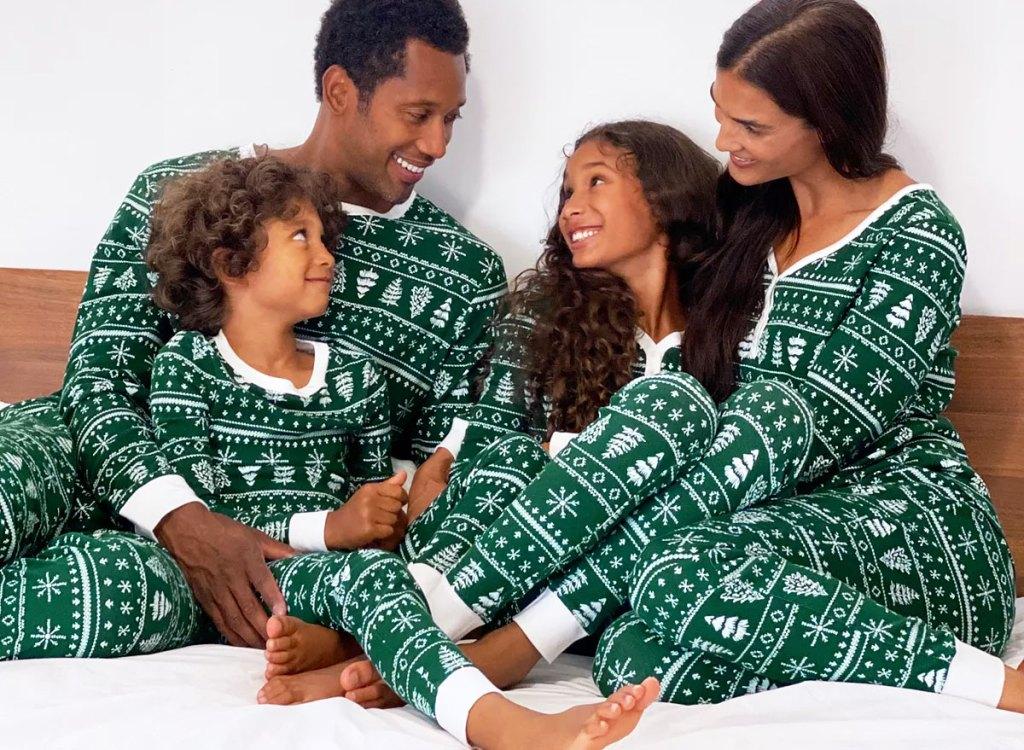 family wearing matching green fair isle print pajamas