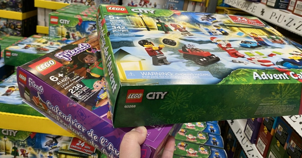 Hand holding up LEGO Advent Calendars at Costco