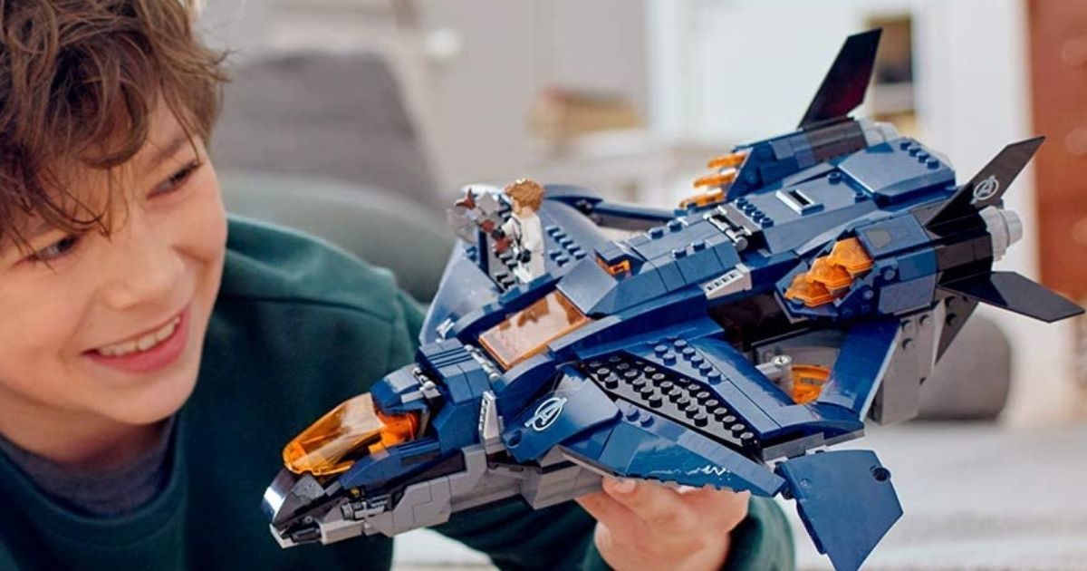 boy playing with LEGO jet set