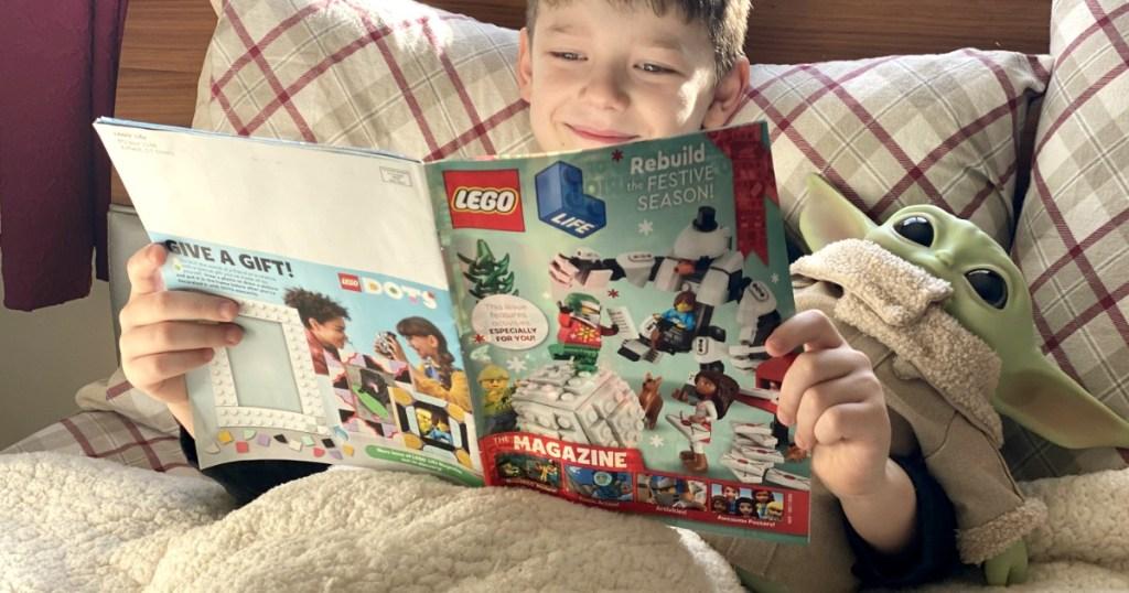 Boy reading a LEGO themed magazine