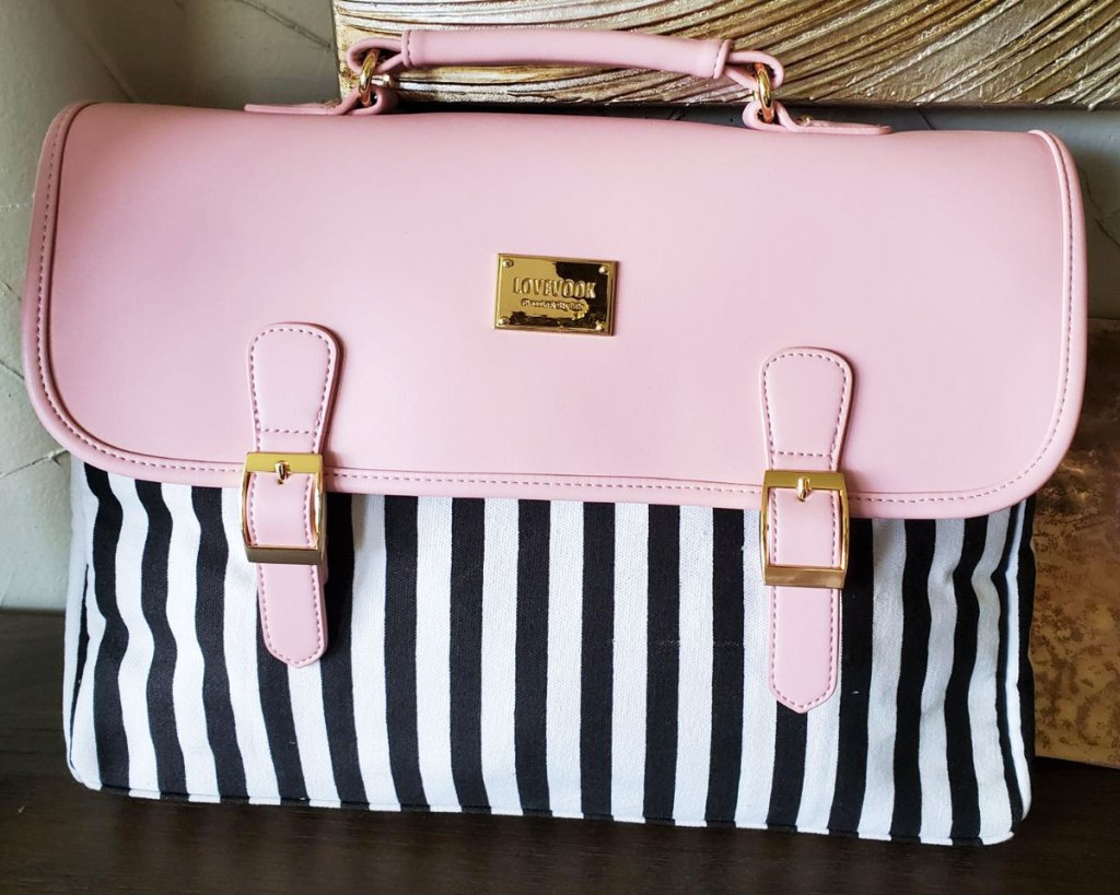 black and white striped laptop case with pink foldover cover and handle on top