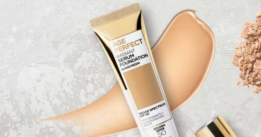 bottle of L'Oréal Age Perfect Radiant Serum Foundation with foundation swatch under the bottle