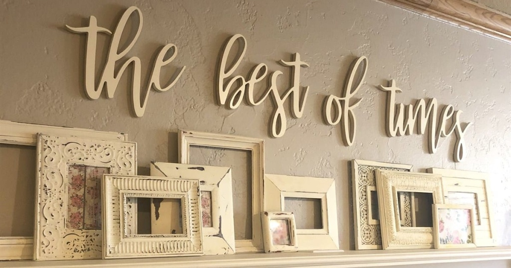 large sign on wall with picture frames