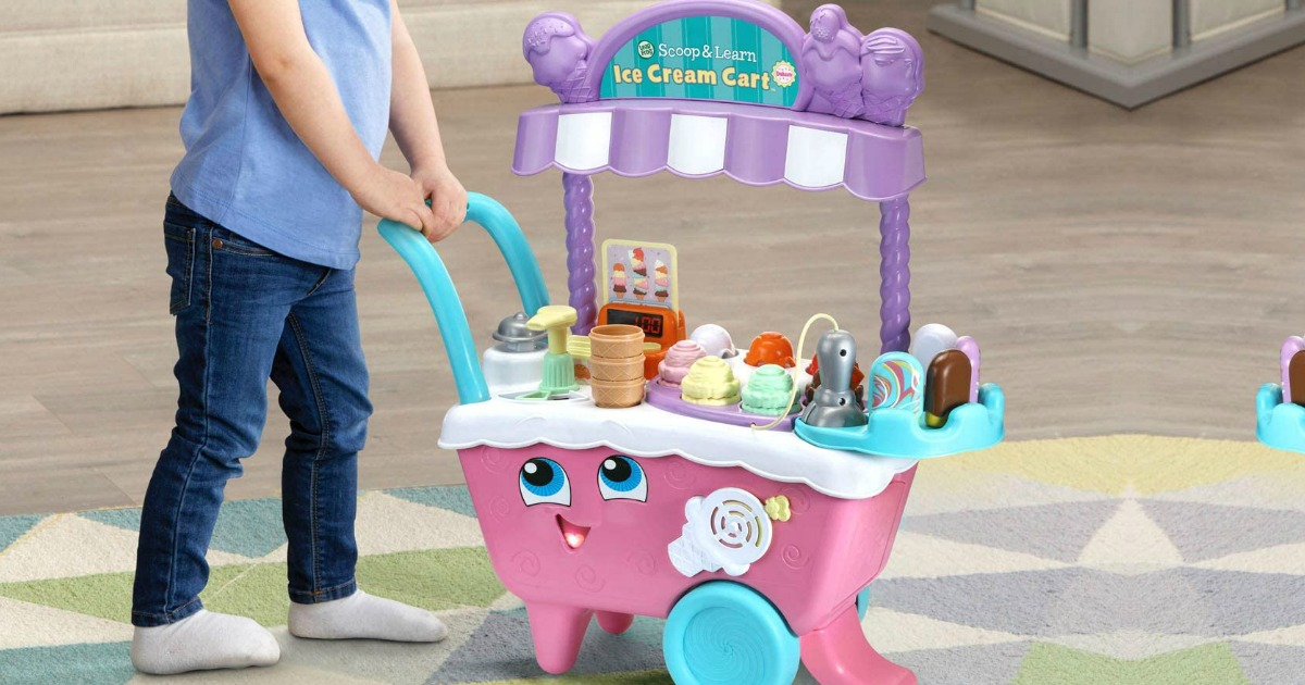 Girl playing with a LeapFrog Scoop and Learn Ice Cream Cart Deluxe