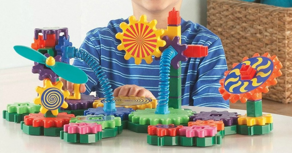 Boy playing with gear building set