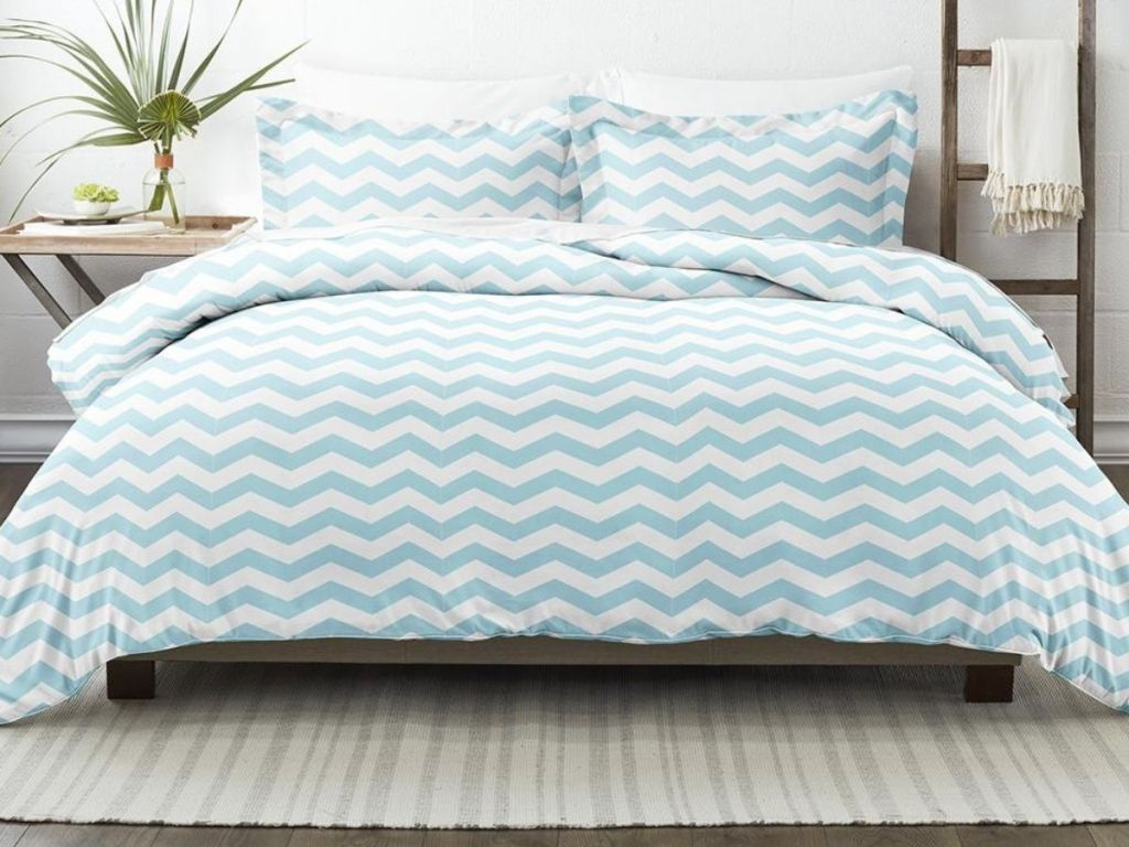 blue and white chevron duvet on bed in bedroom