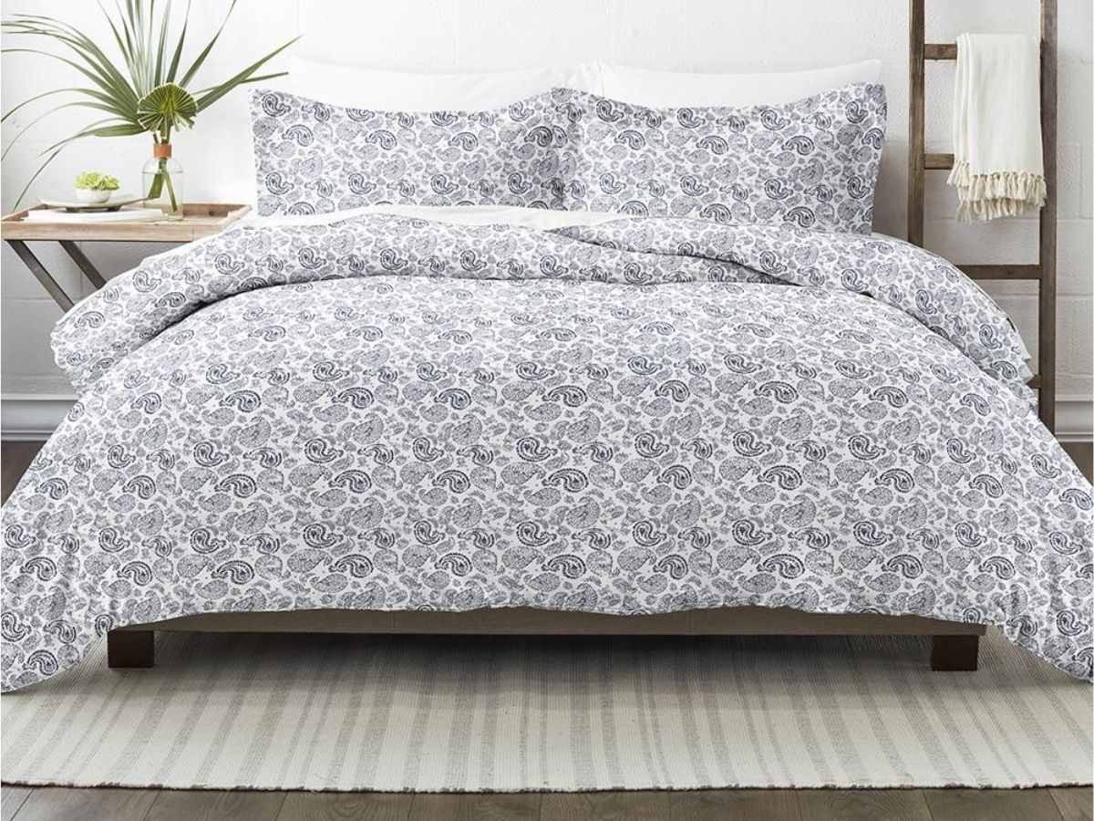 gray and white paisley duvet on bed in bedroom