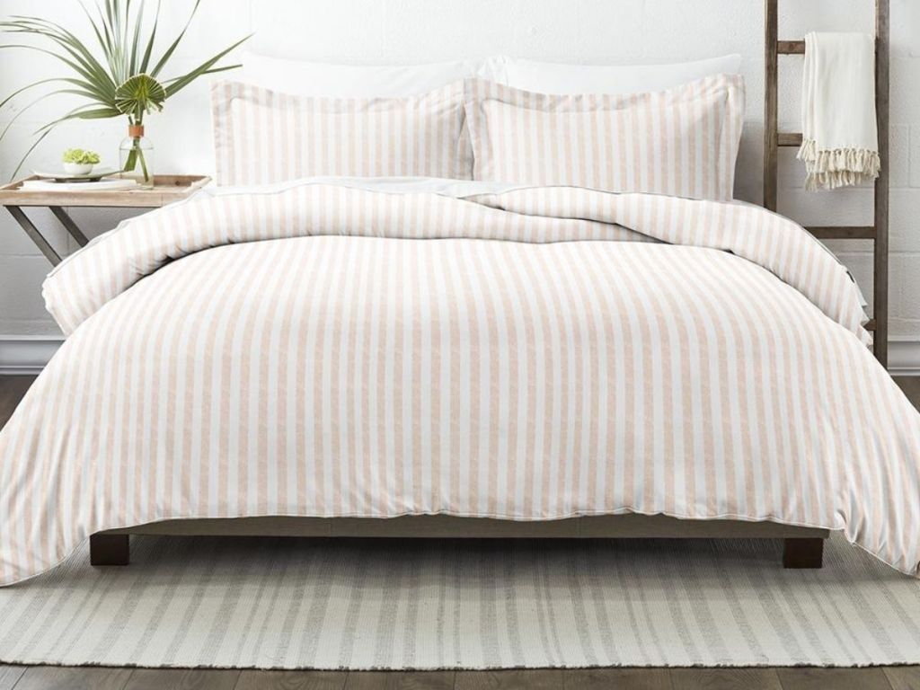 ivory and white striped bedding on bed in bedroom