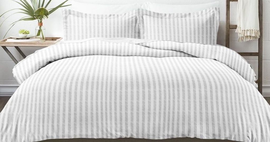 gray and white striped duvet on bed in bedroom