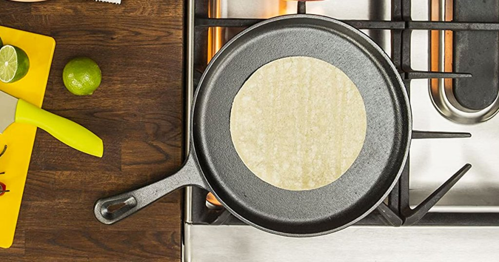 tortilla on a cast iron skillet on top of a stove