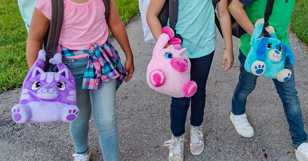 kids walking and carrying plush lunchboxes