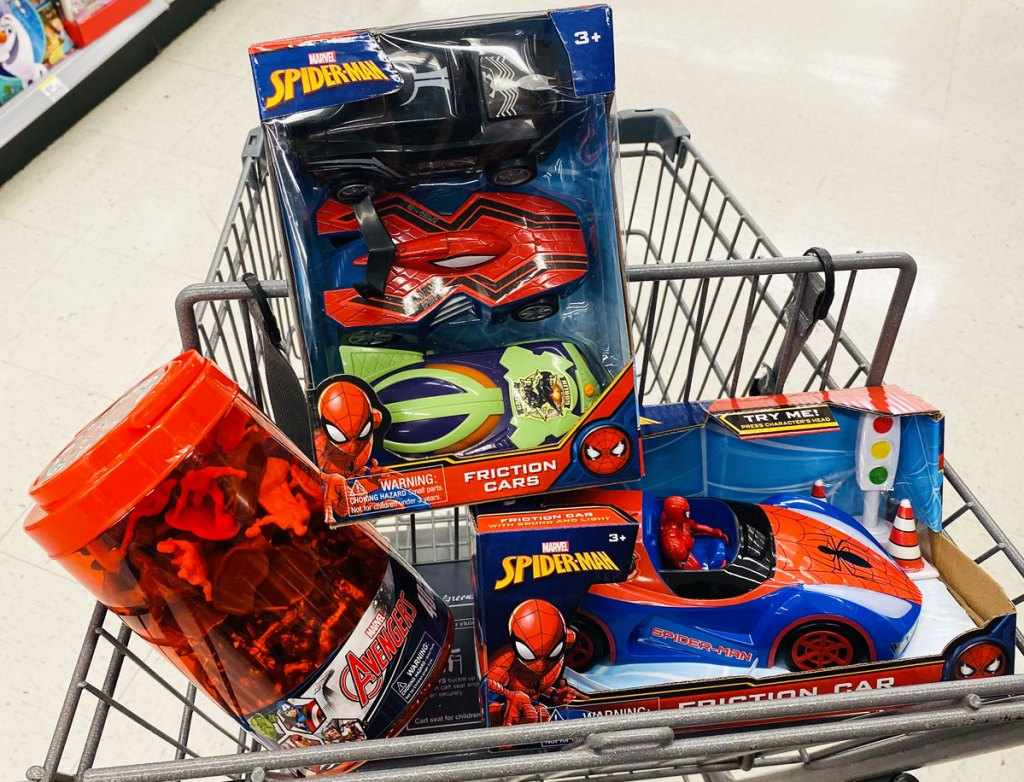 three marvel avengers and spider-man toys inside walgreens shopping cart