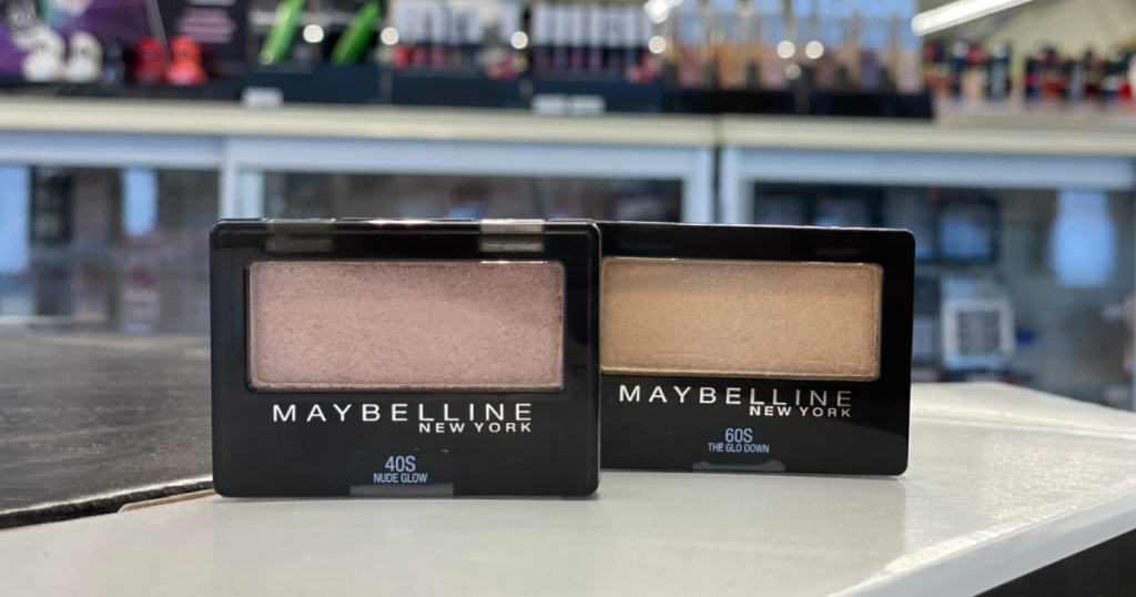 two single eyeshadows on counter in store