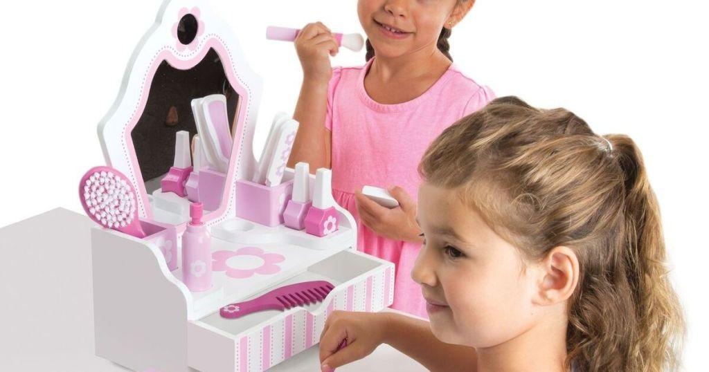 girls playing with a beauty salon set
