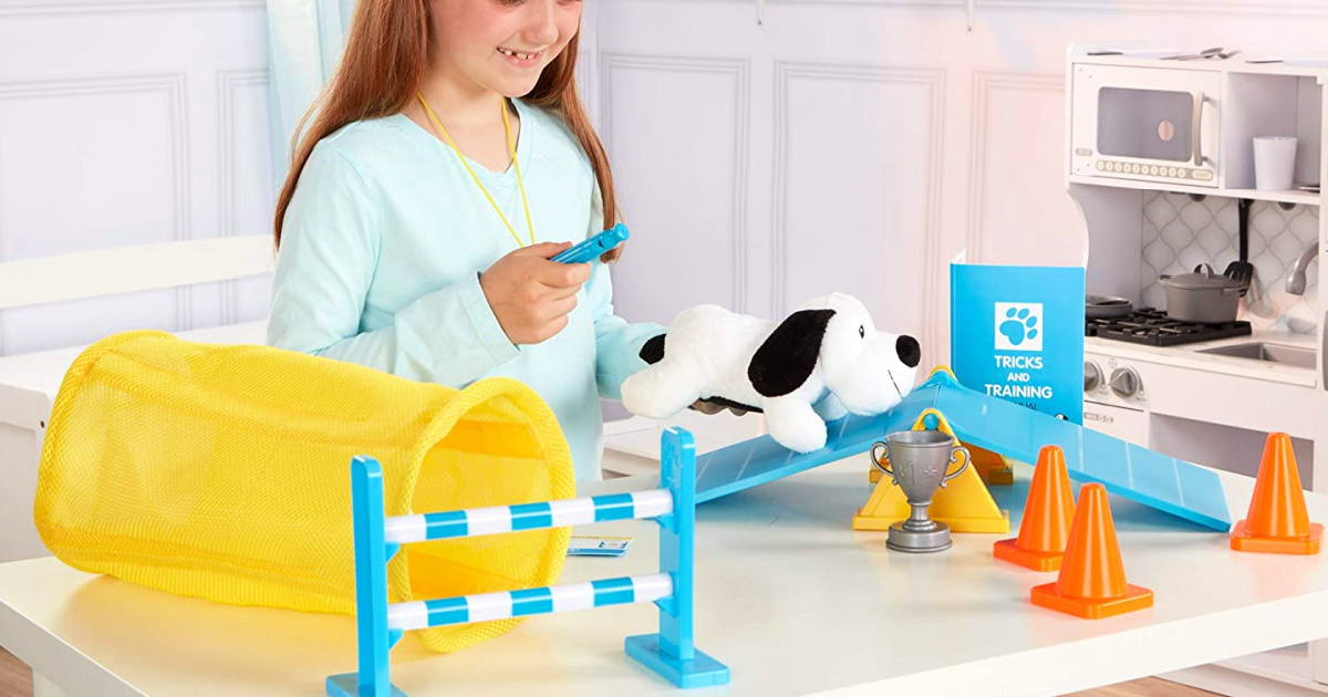 girl playing with a Melissa & Doug Puppy School Play Set
