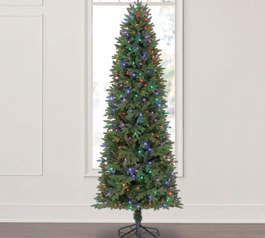 slim christmas tree with mutli-color lights