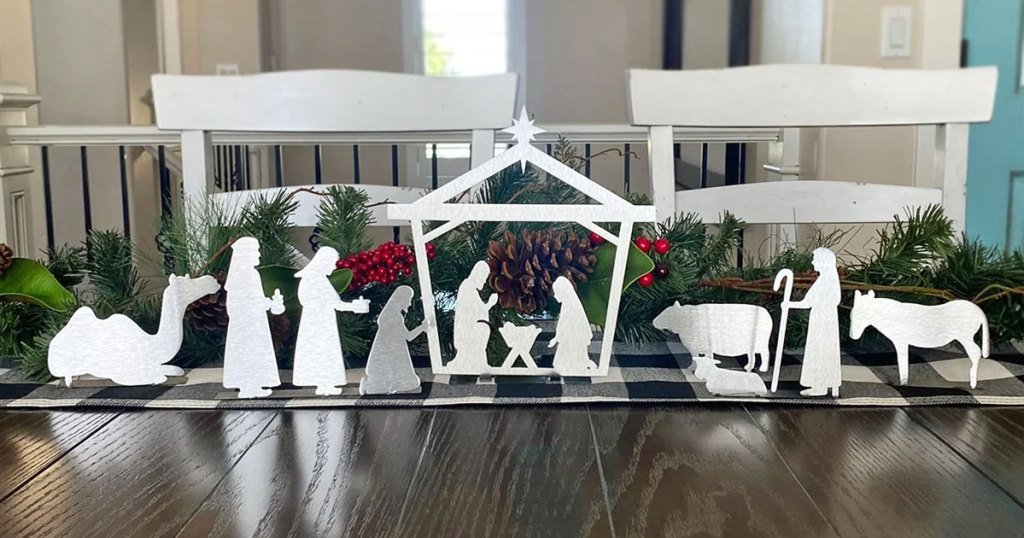 metal nativity scene on a wooden table