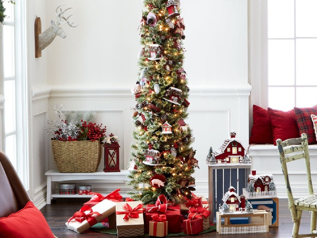 tall skinny christmas tree decorated with lights and ornaments
