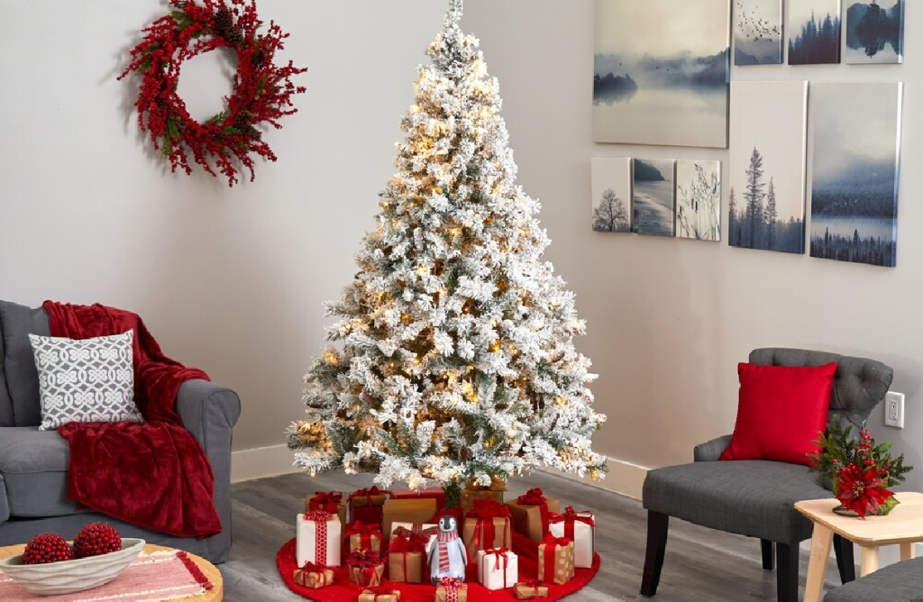 prelit large whte christmas tree in a living room