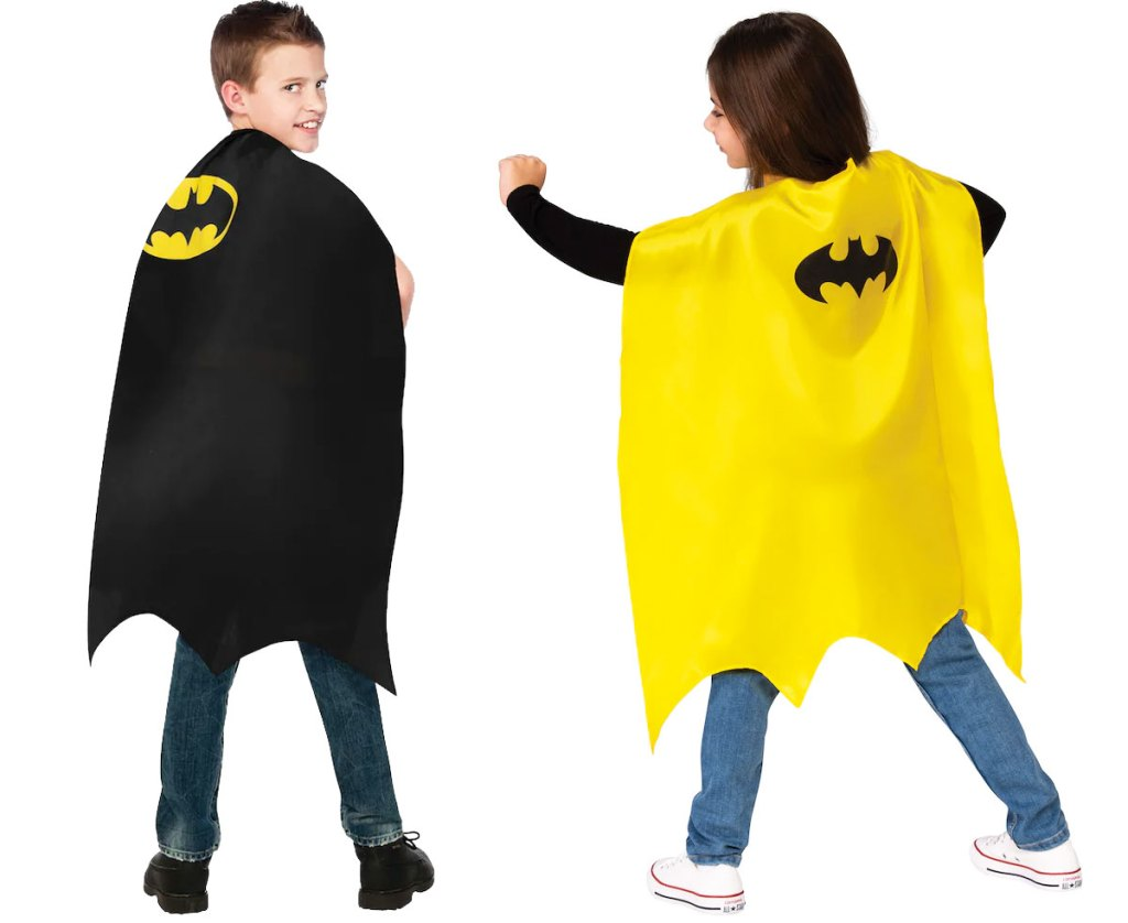 two kids wearing black and yellow batman capes