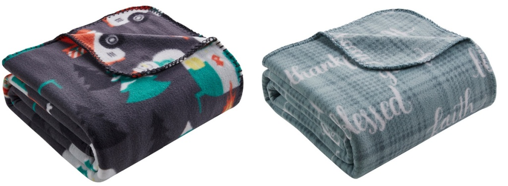 2 folded up holiday fleece throws