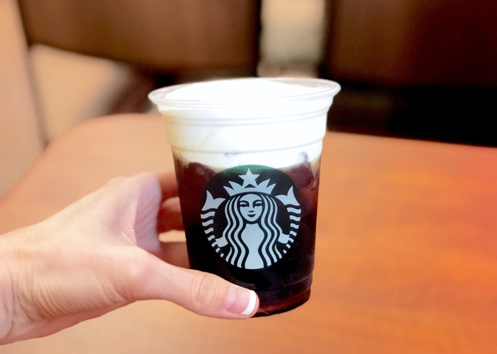 starbucks cup in person's hand
