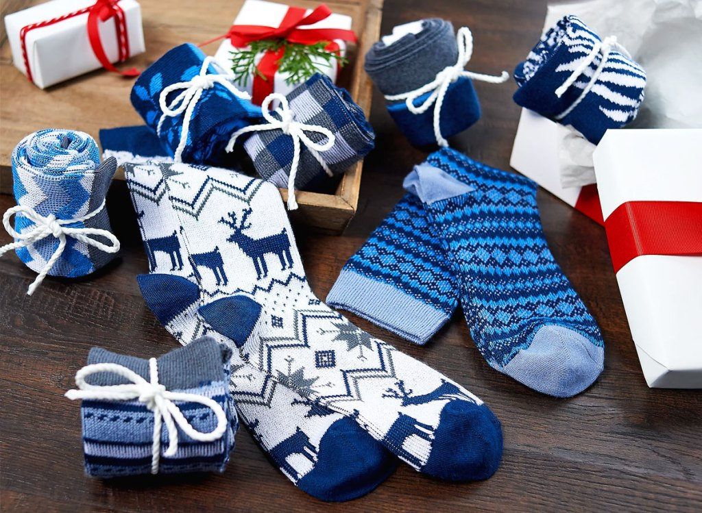 8 pairs of blue and white printed boot stocks with ribbons around them