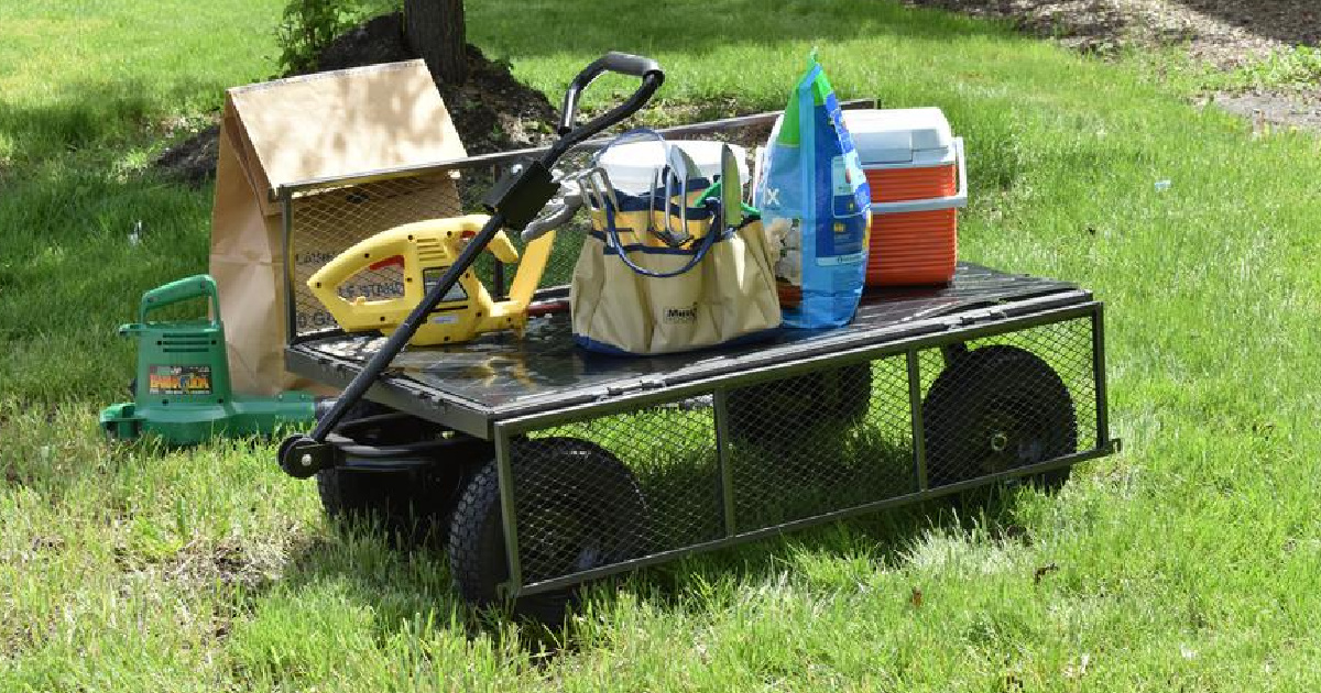utility cart with cooler, mulch, and more in grass
