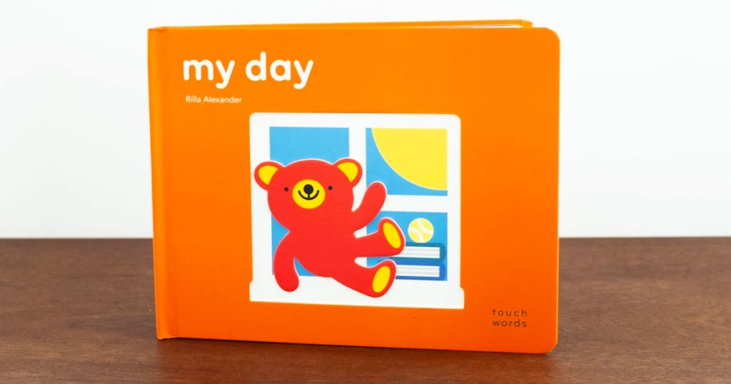 orange hardcover interactive board book about things children do during the day