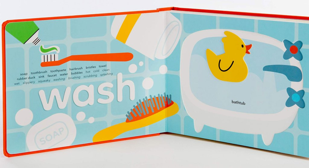 inside view of children's interactive board book with a page learning about the word wash and bathtub