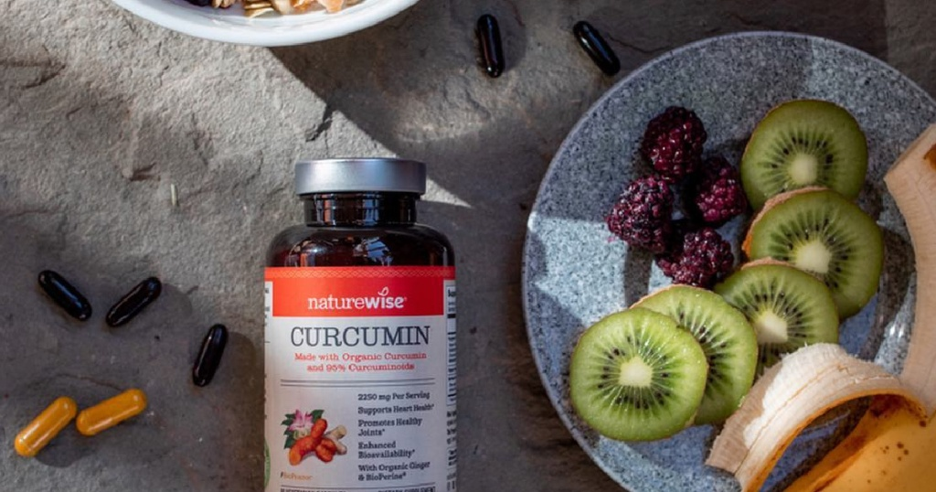 fruit on plate with bottle of NatureWise Curcumin Turmeric 2250mg (2 Month Supply – 180 Count)