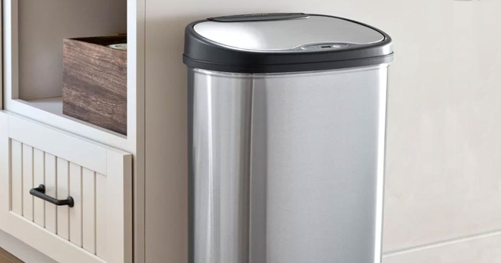 stainless steel sensor trash can against island in kitchen